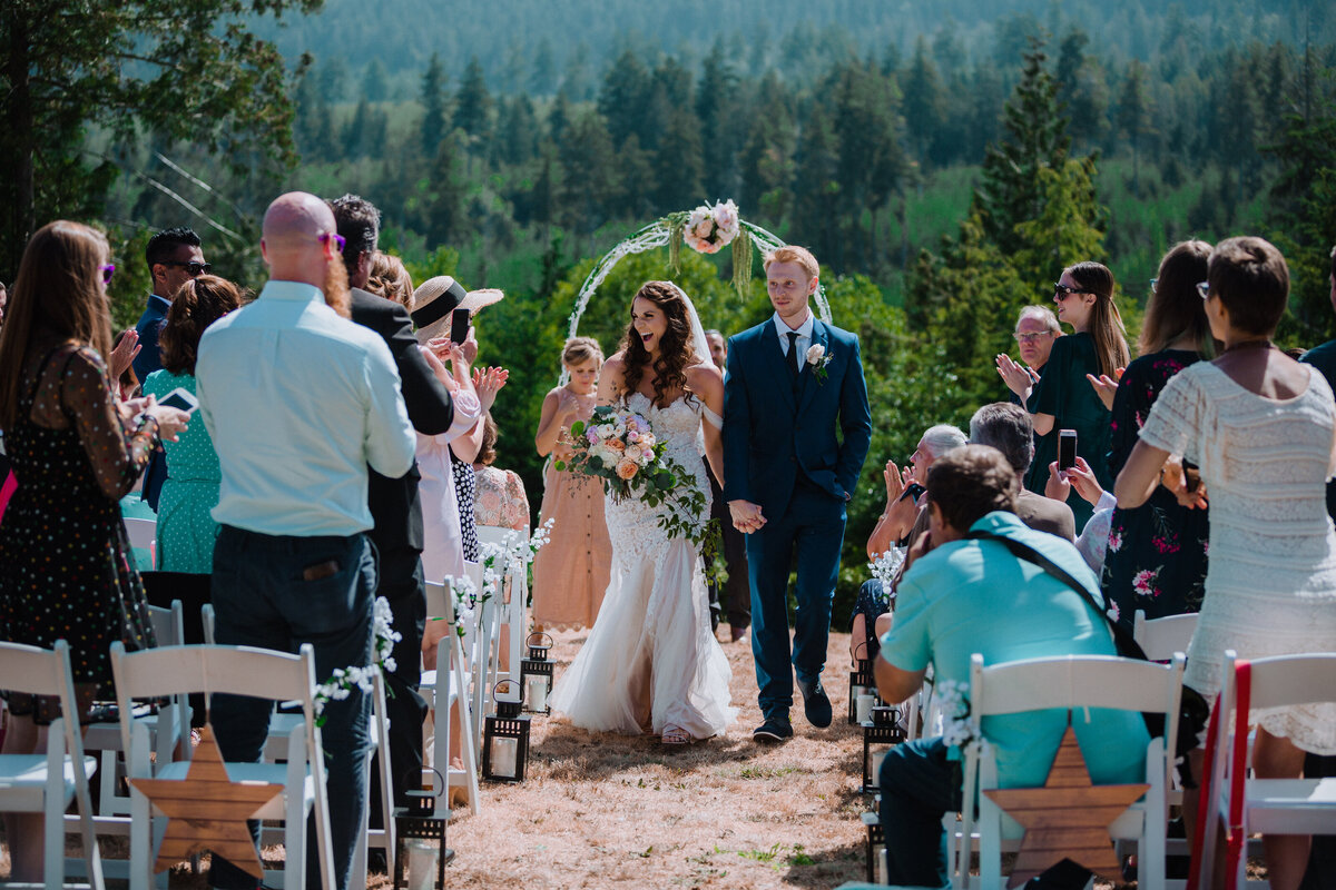 Couple excitedly walking down the isle after getting married