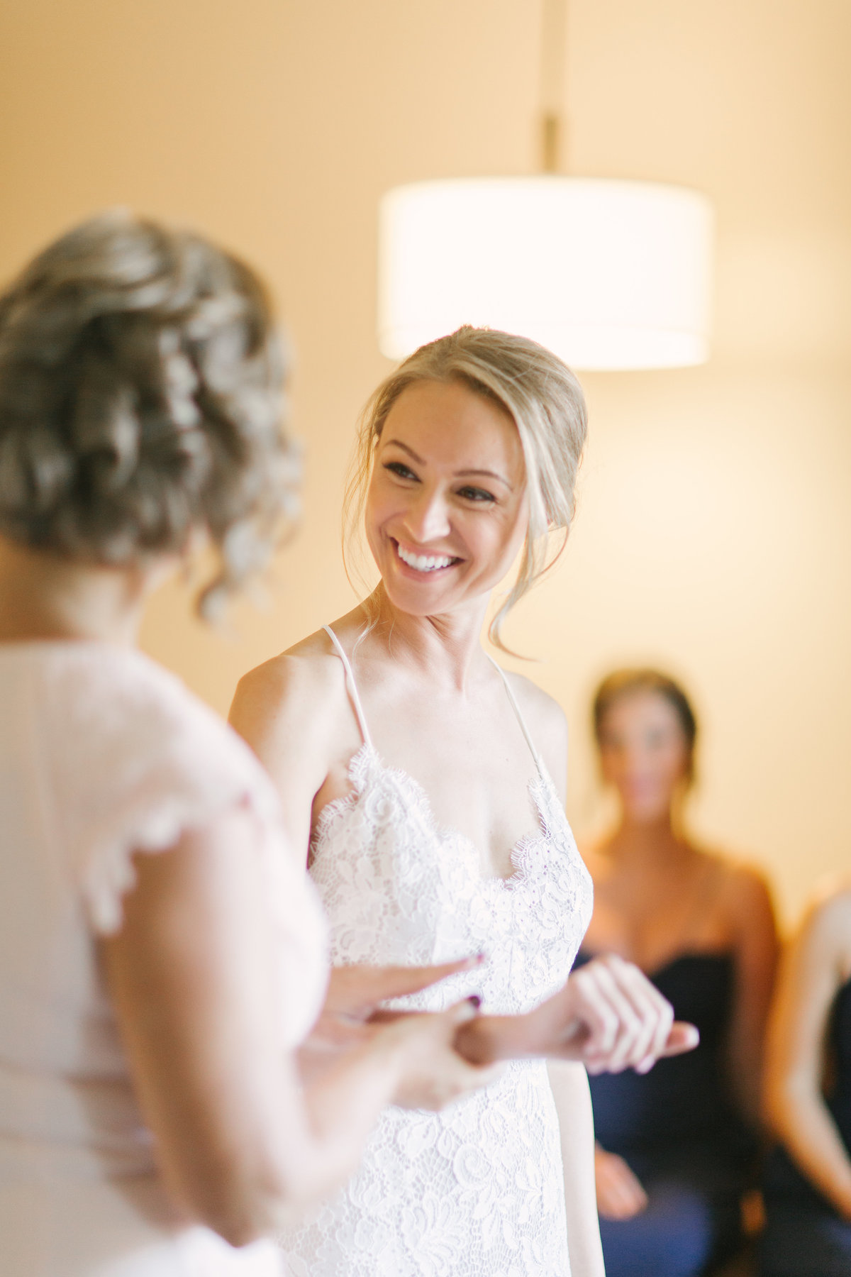 Mother of the bride looks at daughter prior to Firestone Winery Wedding