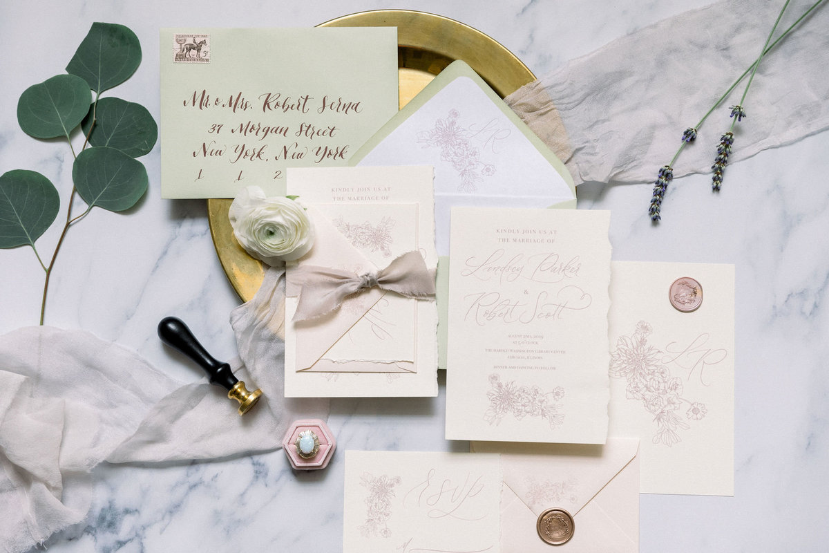invitation suite with ring and flowers
