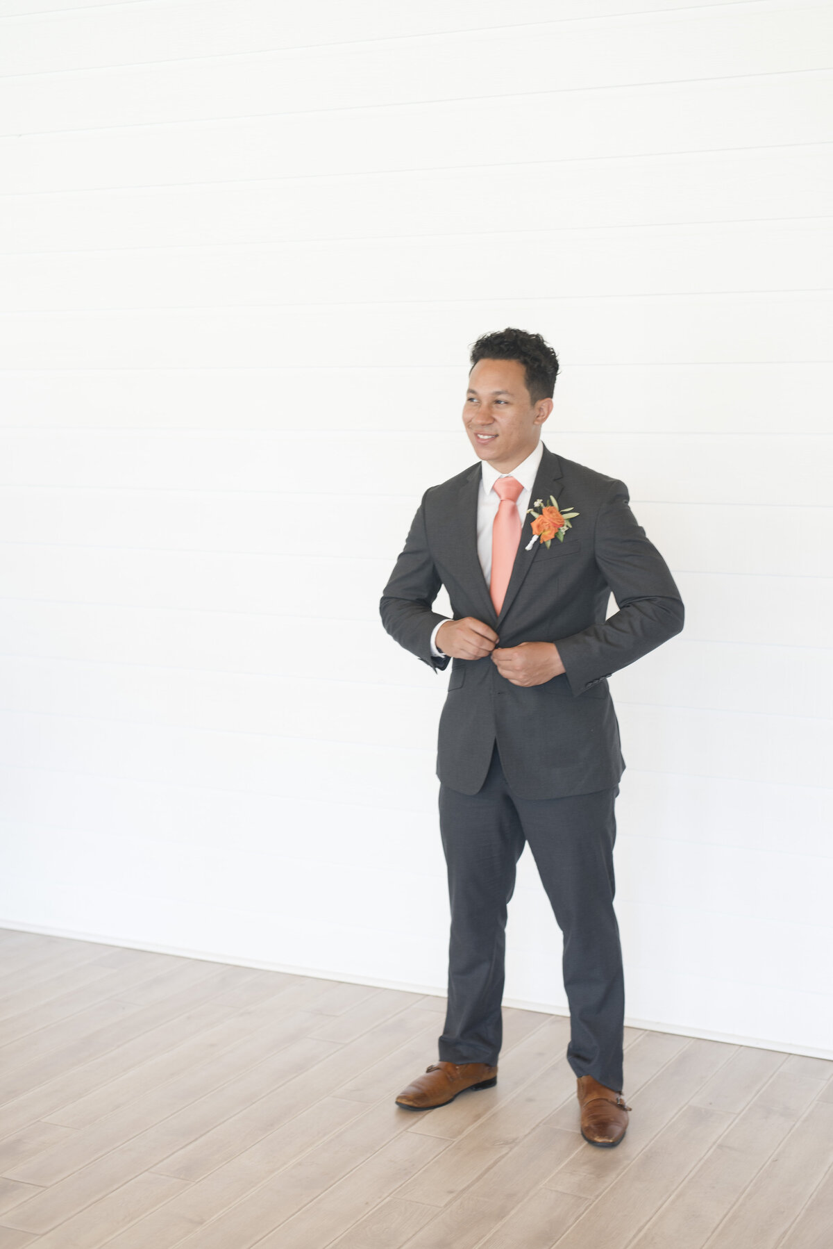 Groom standing for wedding photos for Fort Worth wedding