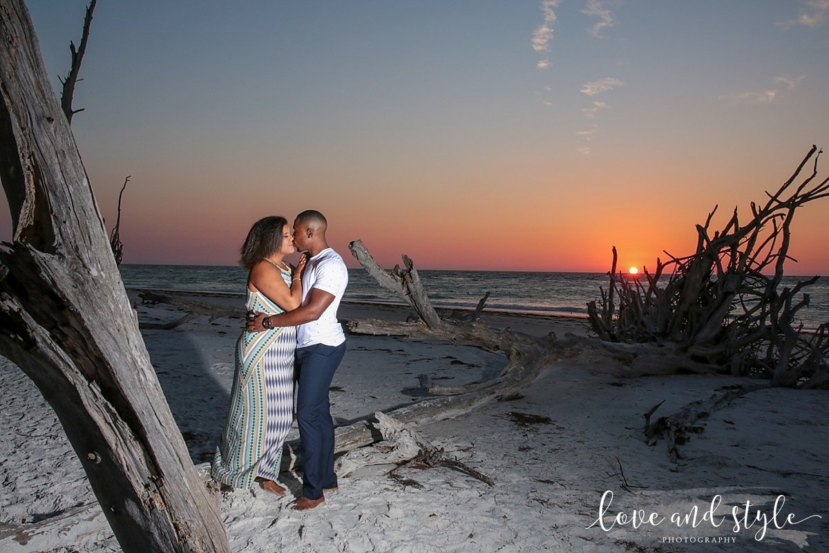 Bradenton Engagement Photography on Beer Can Island at sunset with driftwood