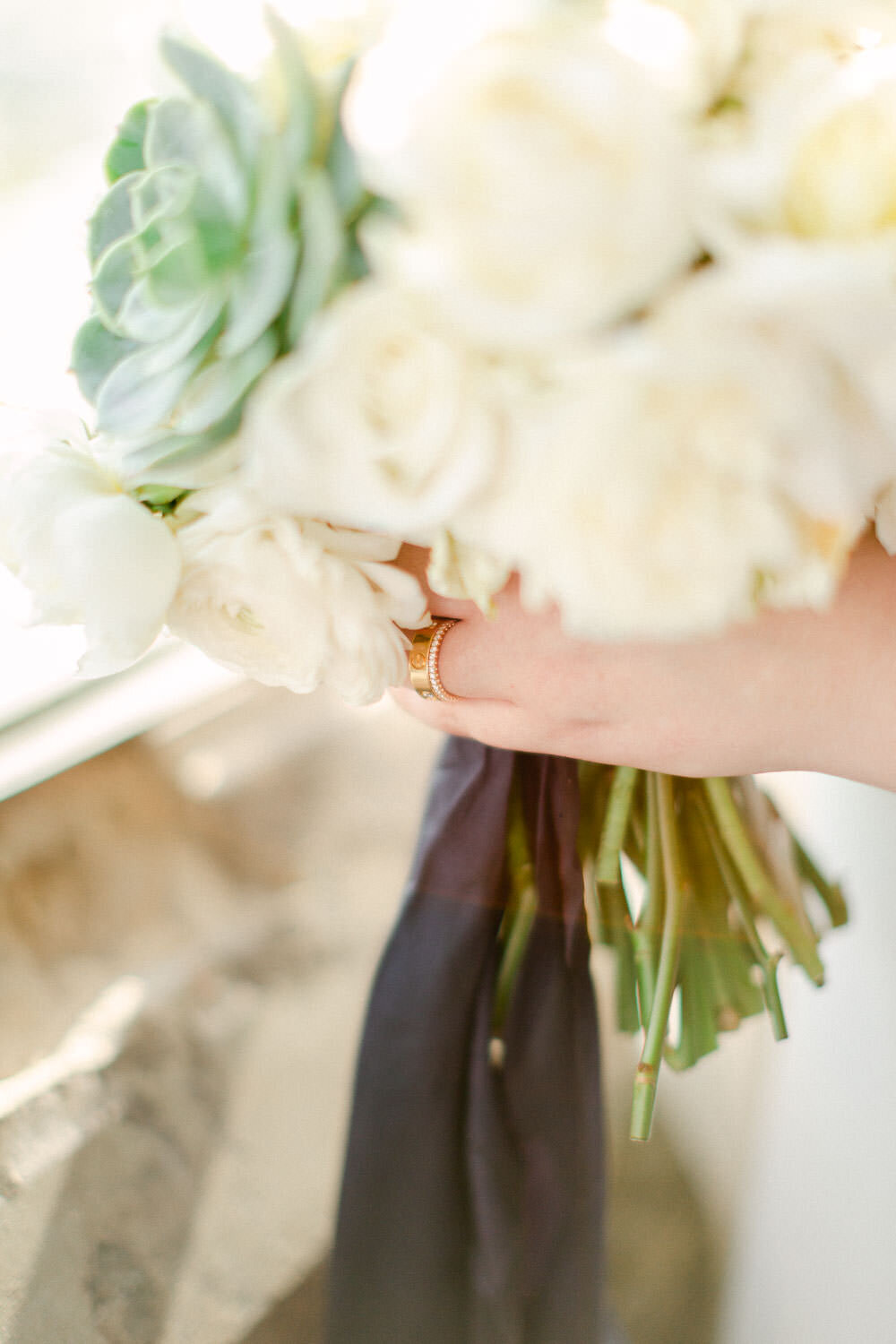 Wedding bride holding bouquet