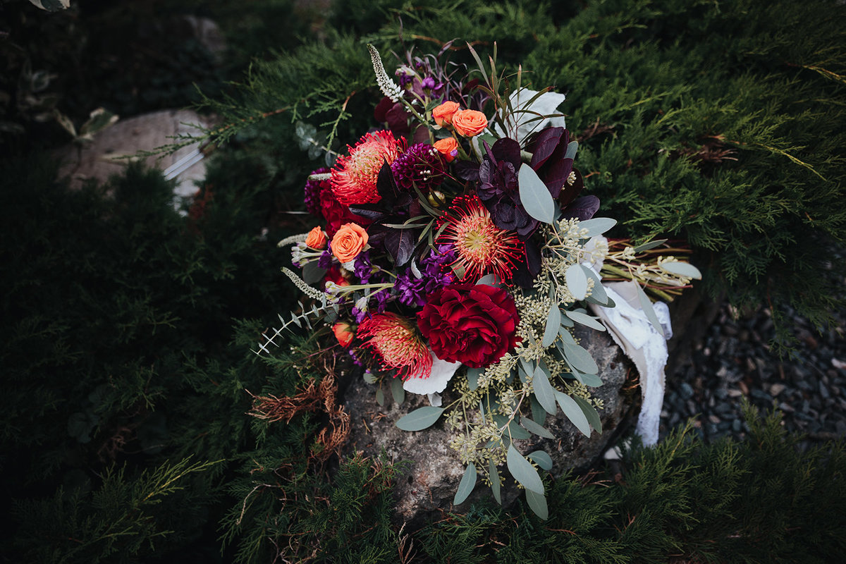 Orange and purple bridal bouquet