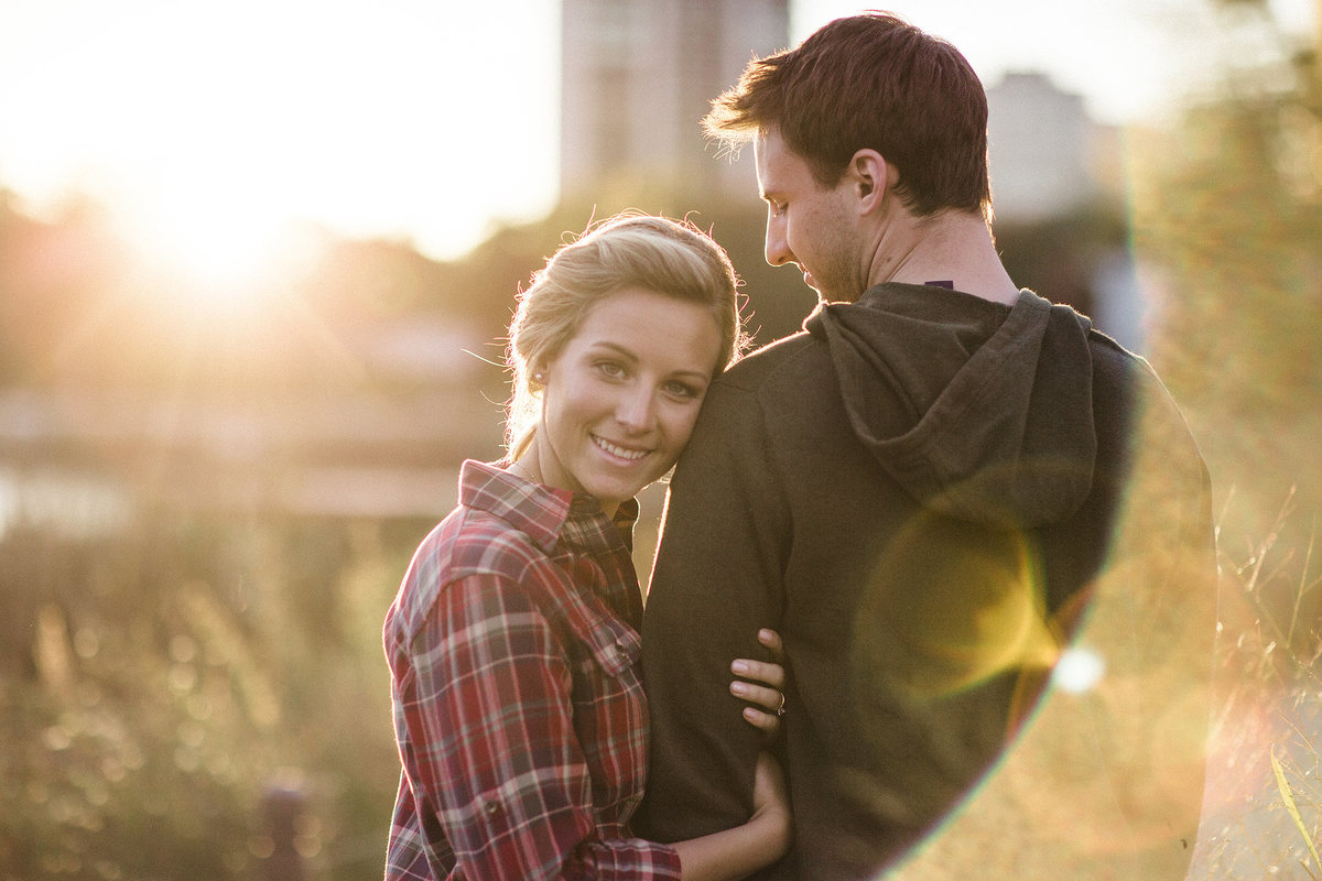 couple at sunset during their engagement photography session in Lincoln park in chicago illinois