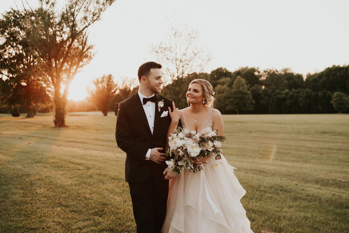 groom and bride sunset mainline florist
