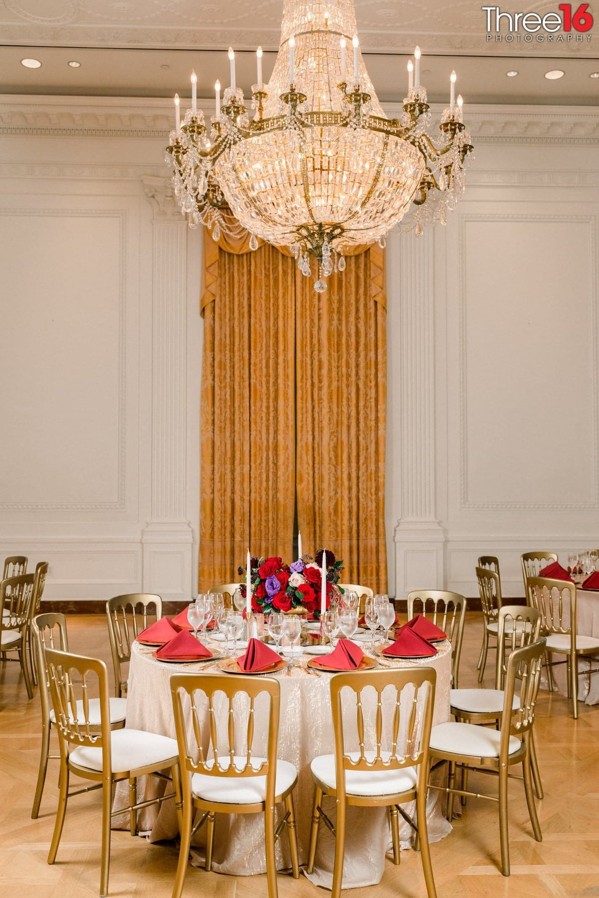 Richard Nixon Library wedding reception table display with long vertical drapes in the background