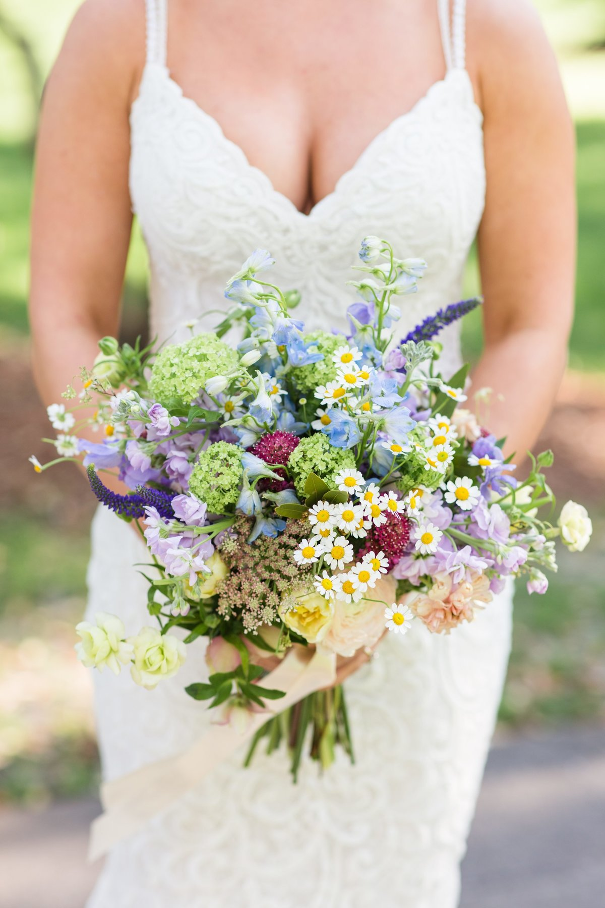 bride holding wedding flowers