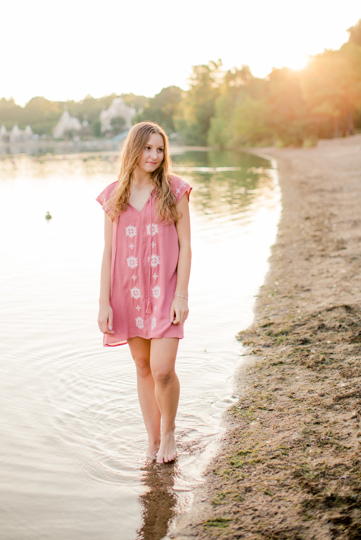 walking along the shores of lake harriet in minneapolis for senior photography