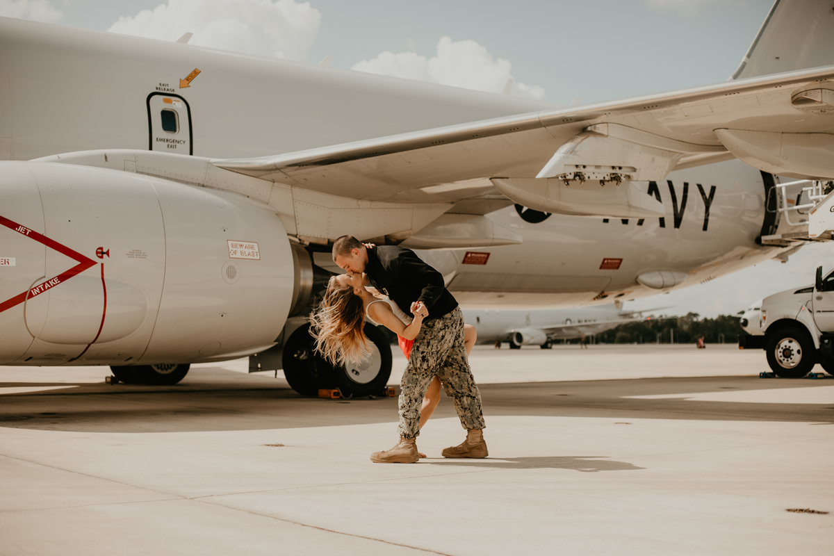 Okinawa Homecoming Photographer, Sailor dipping his wife back after a long deployment