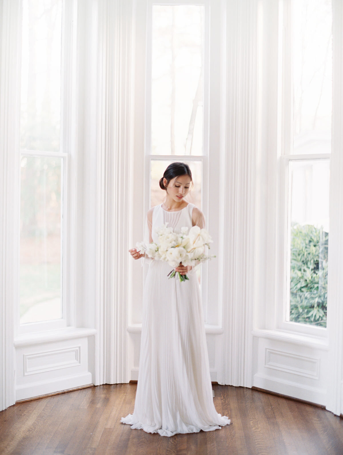 A Greensboro wedding photographer capture a bride at a modern wedding day at McAlister Leftwich wedding venue.