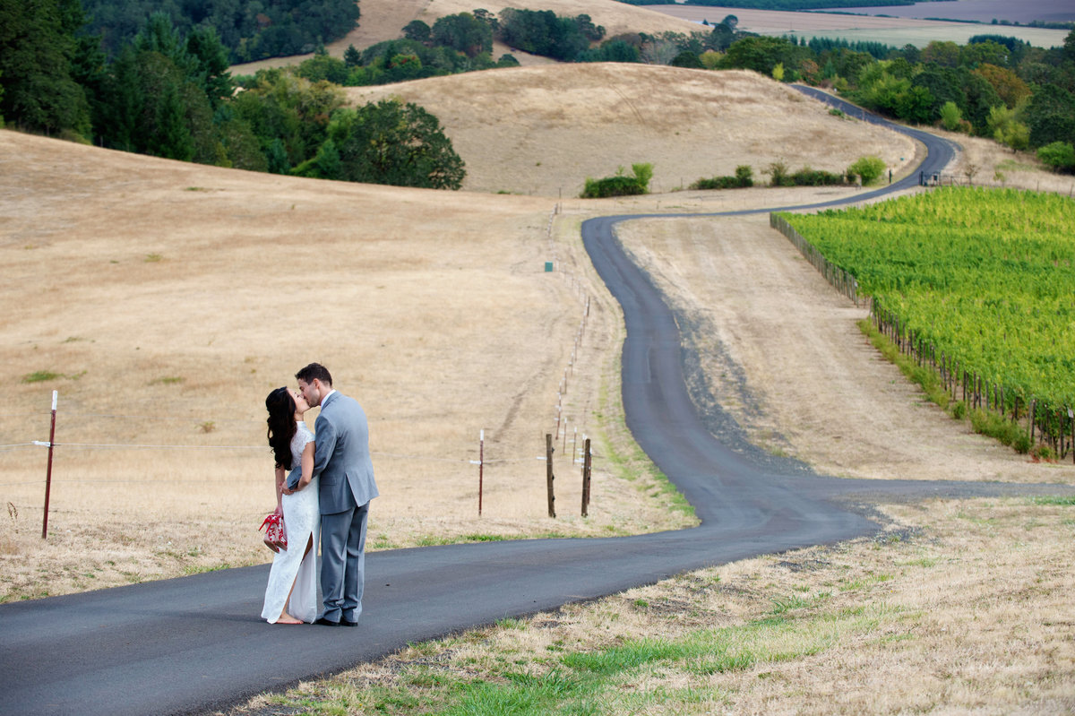 couple walk down long road at youngberg hill