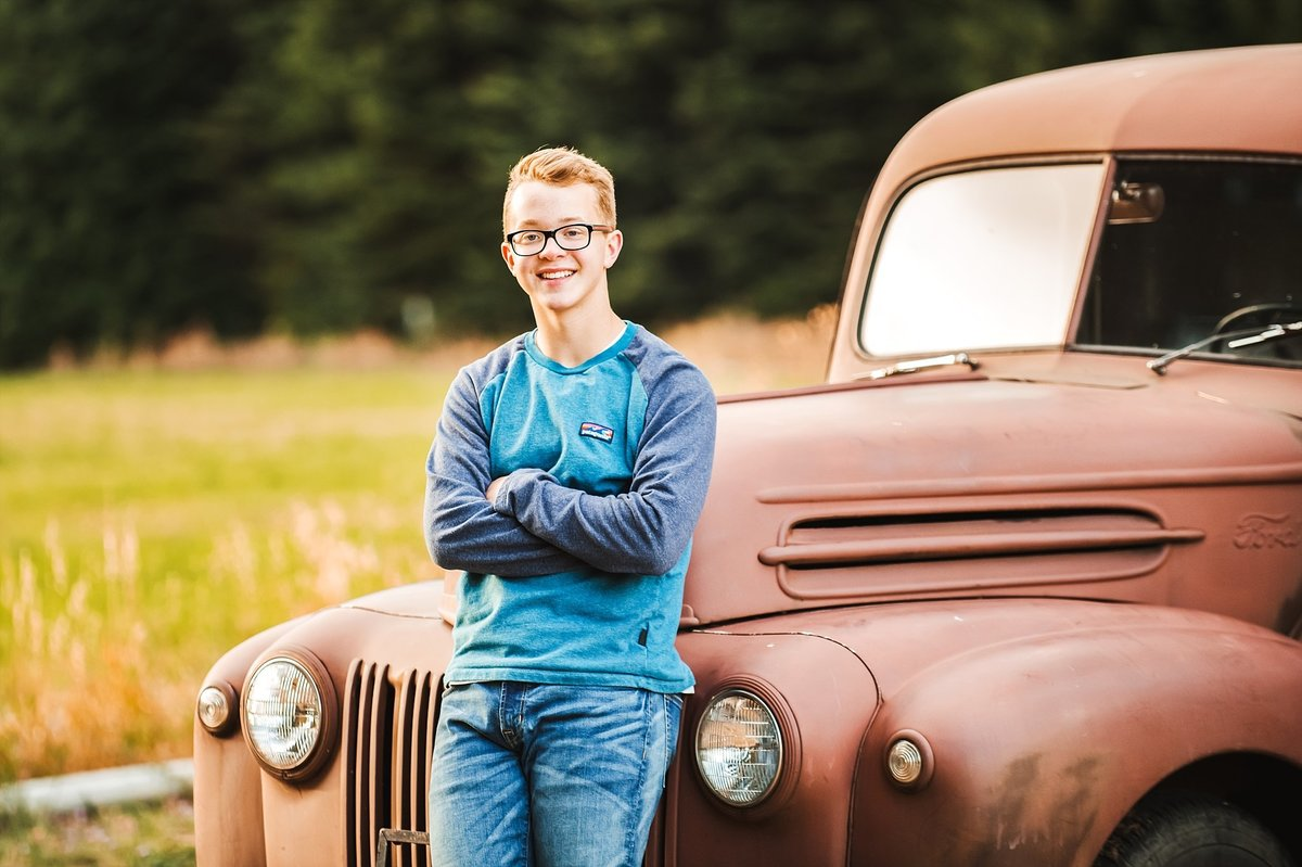 Photo of teenage boy with vintage truck by Ellensburg Family Photographer