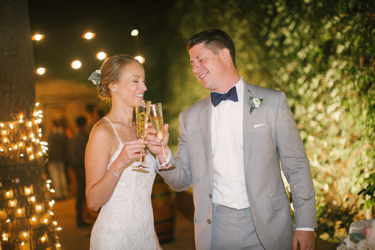 Bride and groom cheers at Firestone Vineyard Wedding