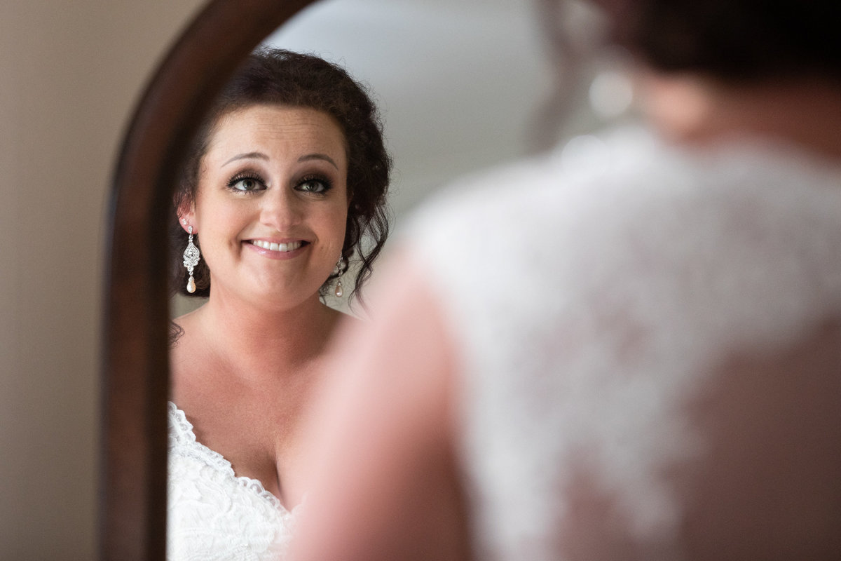 Bride seeing herself in her wedding dress