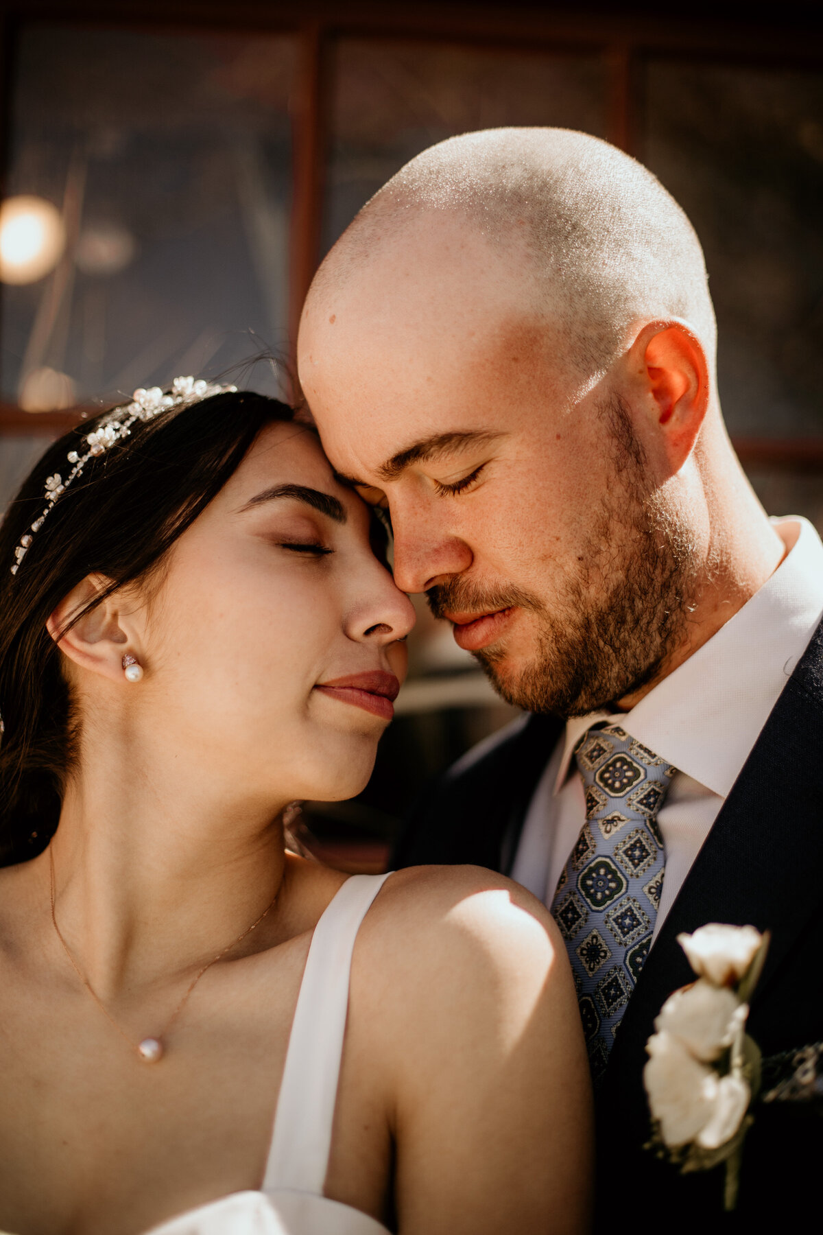 Bride and groom with heads close together