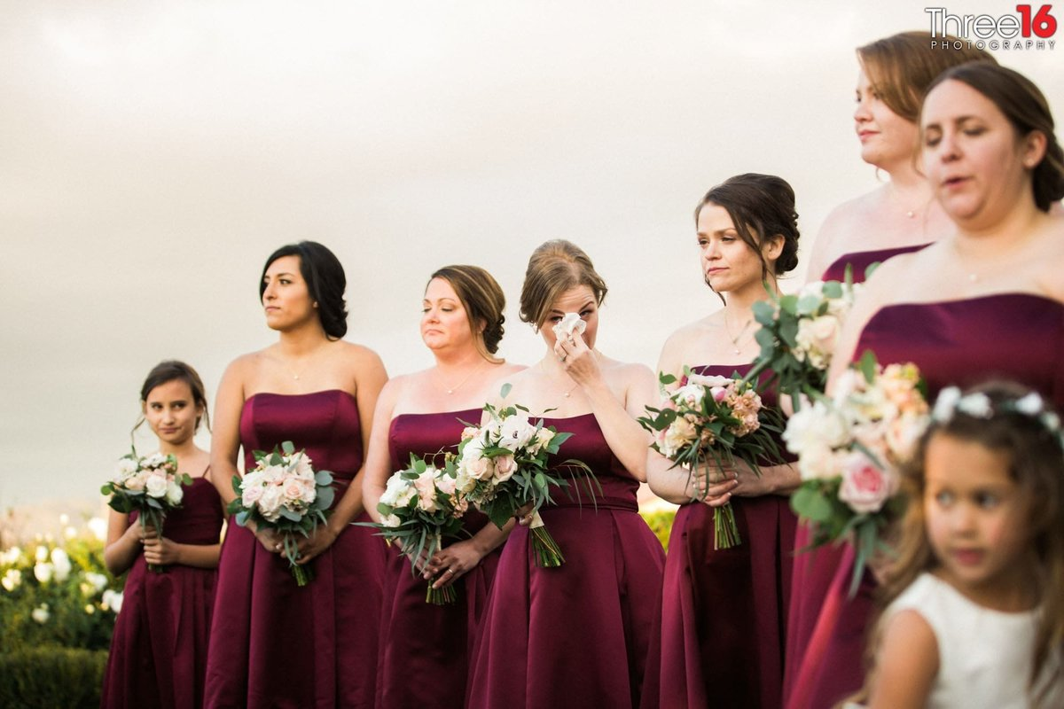Bridesmaids wait during photo session