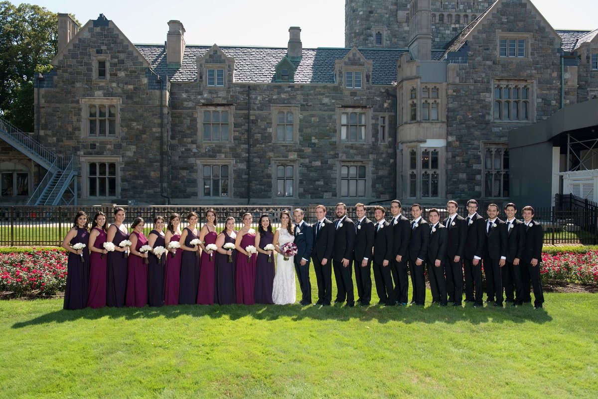 Bridal party standing in front of Hempstead House