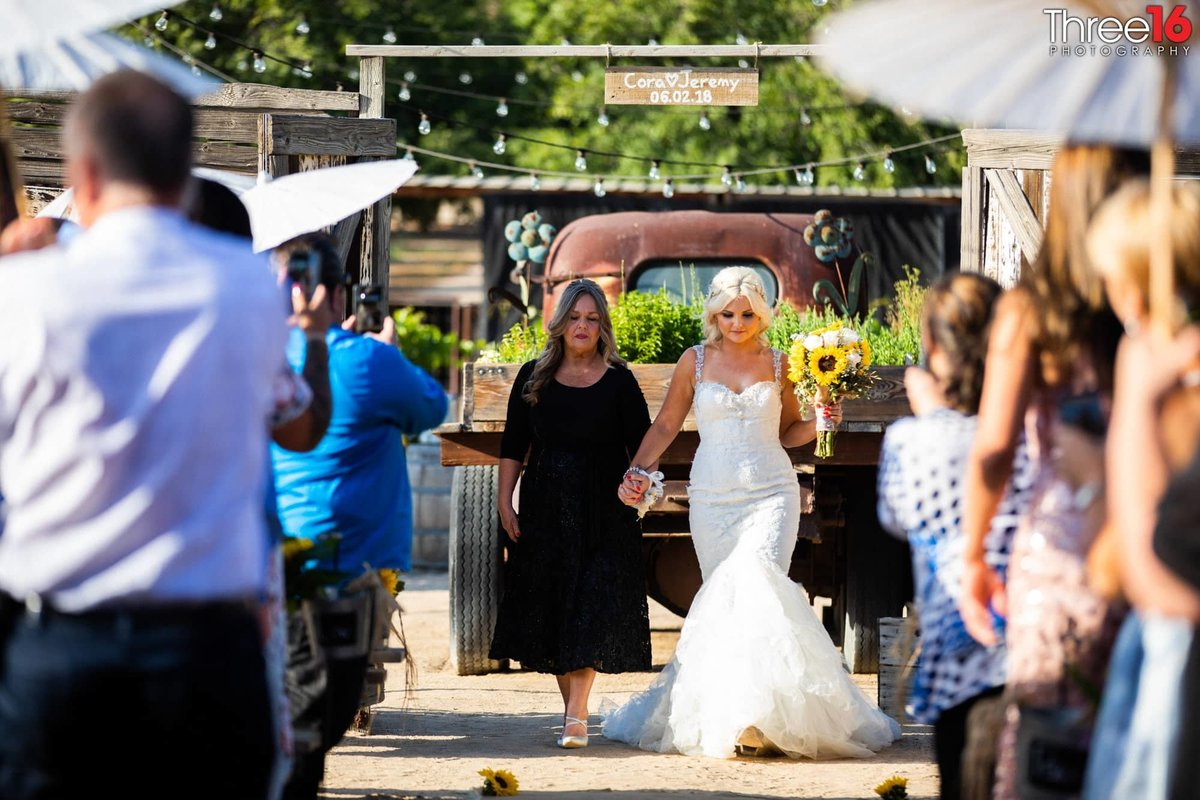 Mother of Bride walks her daughter down the aisle