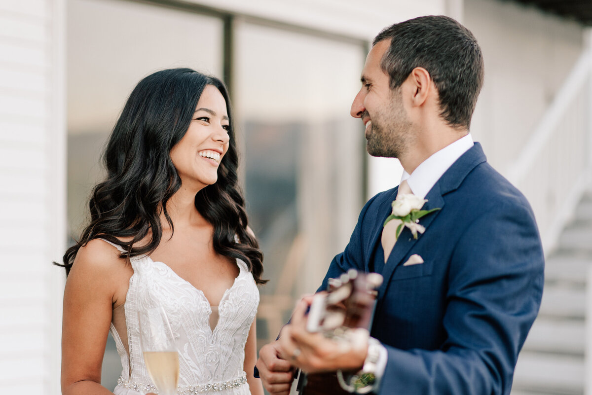 Groom playing guitar for bride during Lake Chelan summer elopement