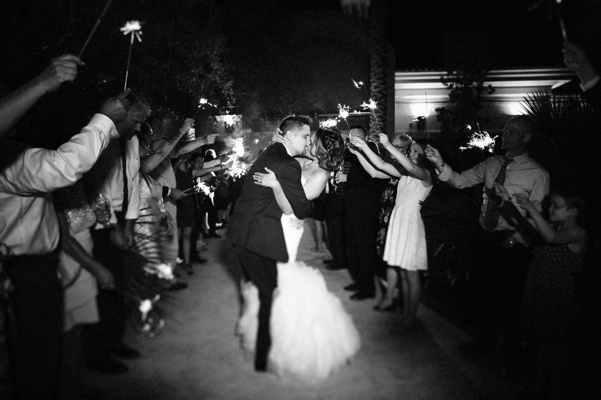 Lake Tahoe wedding pictures bride and groom kiss during sparkler exit