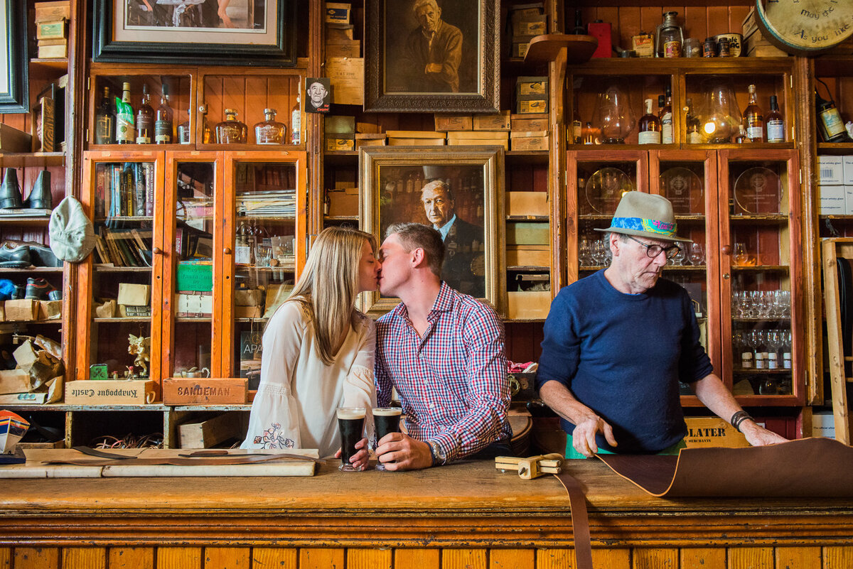 Young couple kissing in an traditional Irish pub in Dingle