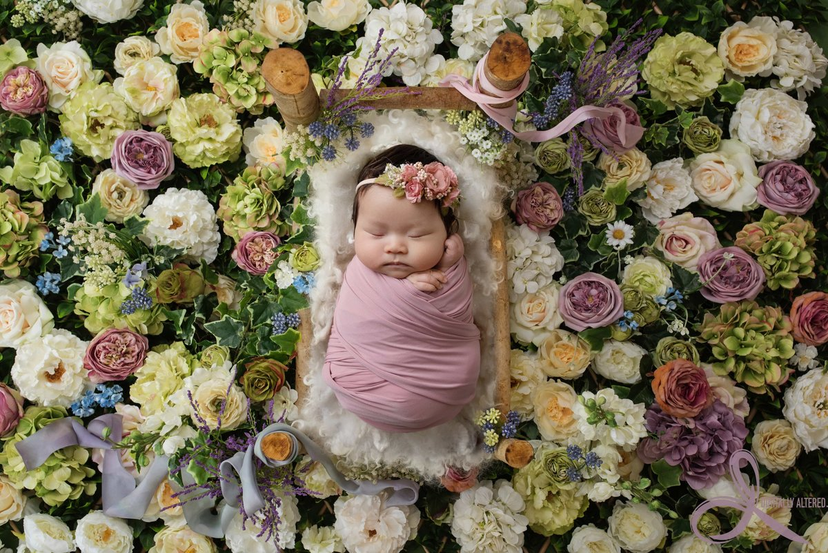 Little girl in a bed of flowers