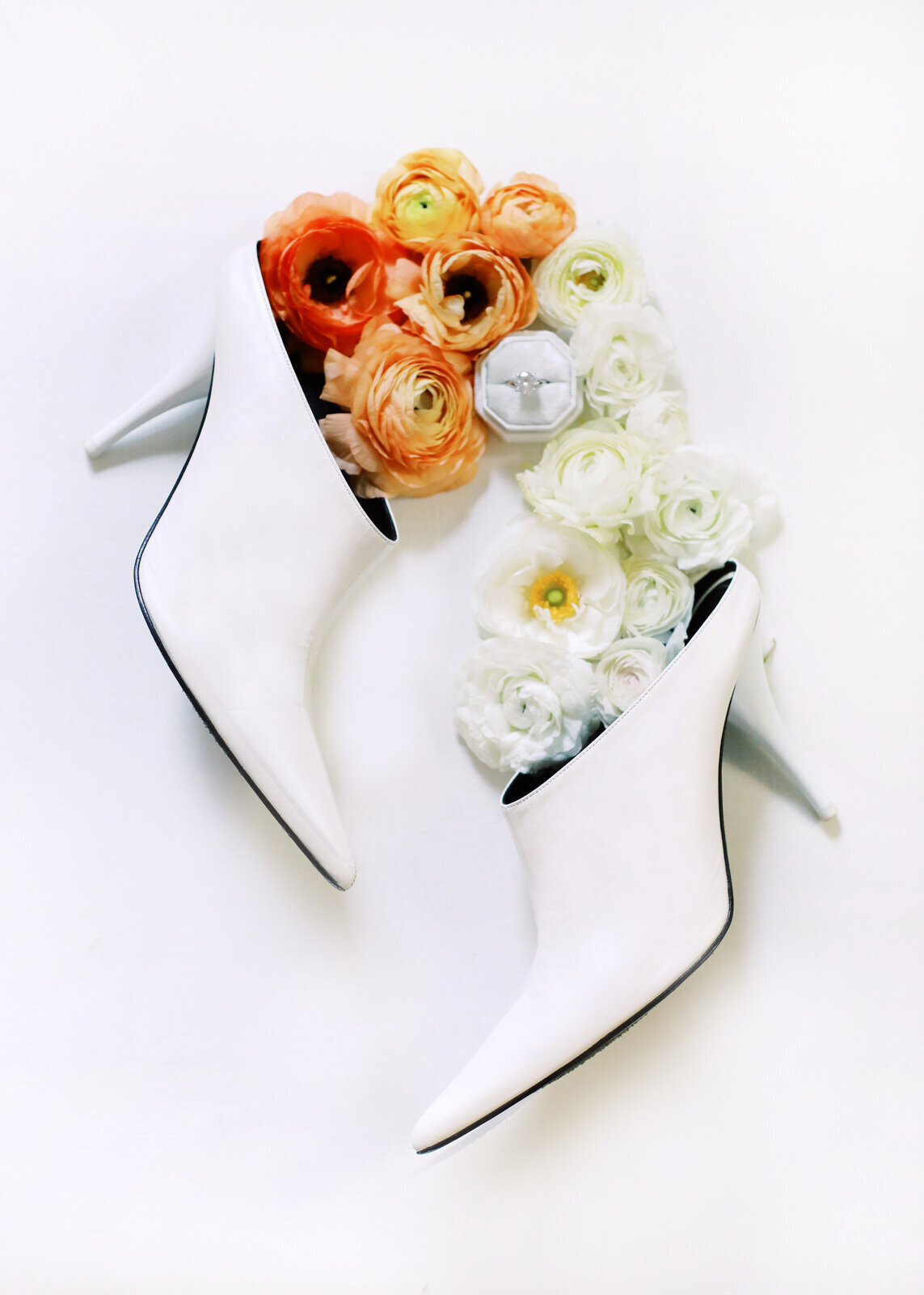 A Greensboro wedding photographer photographs a pair of bridal Celine shoes during a DC wedding day.