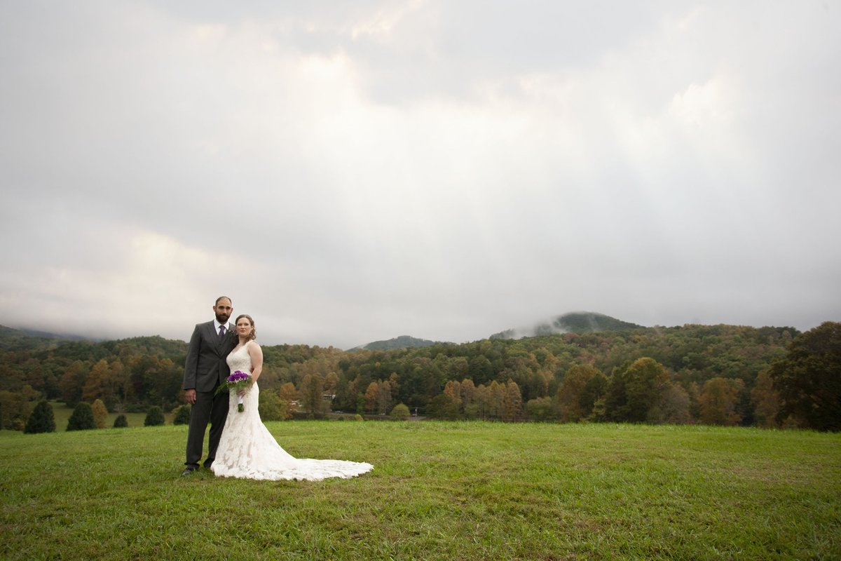 Bridal and groom standing in front of mountains