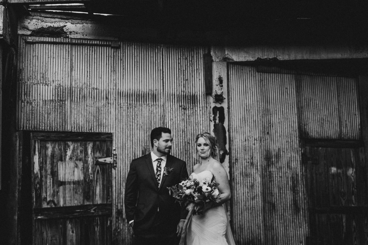 wedding couple in courtyard of Strongwater in Columbus Ohio