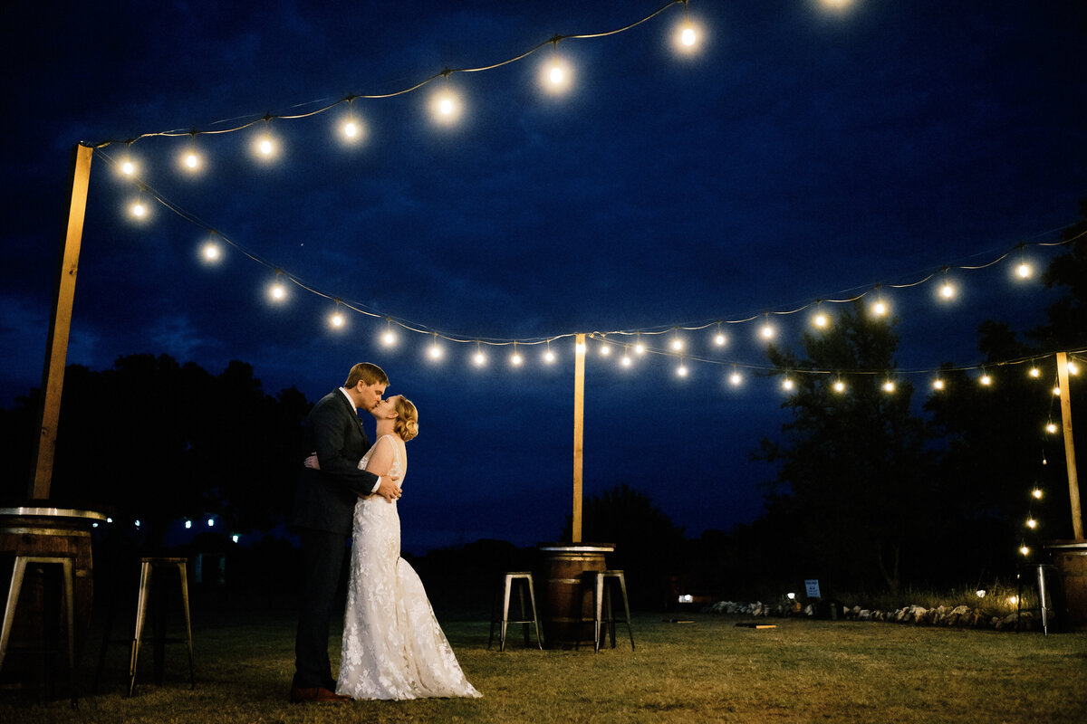 Couple embracing under twinkle lights