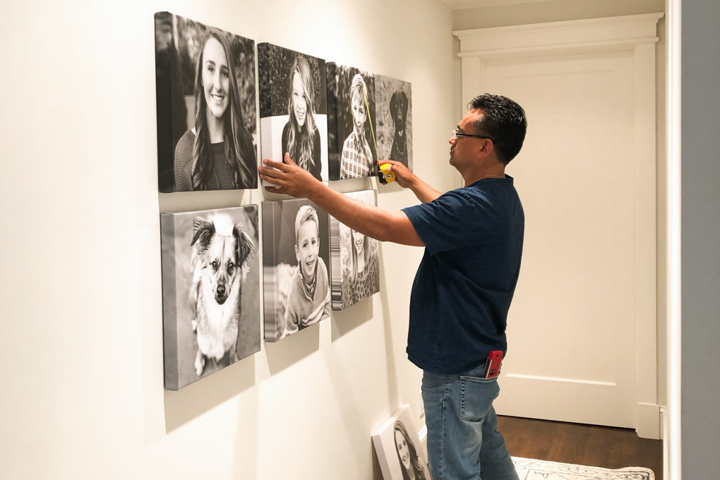 black and white wall art portraits installation