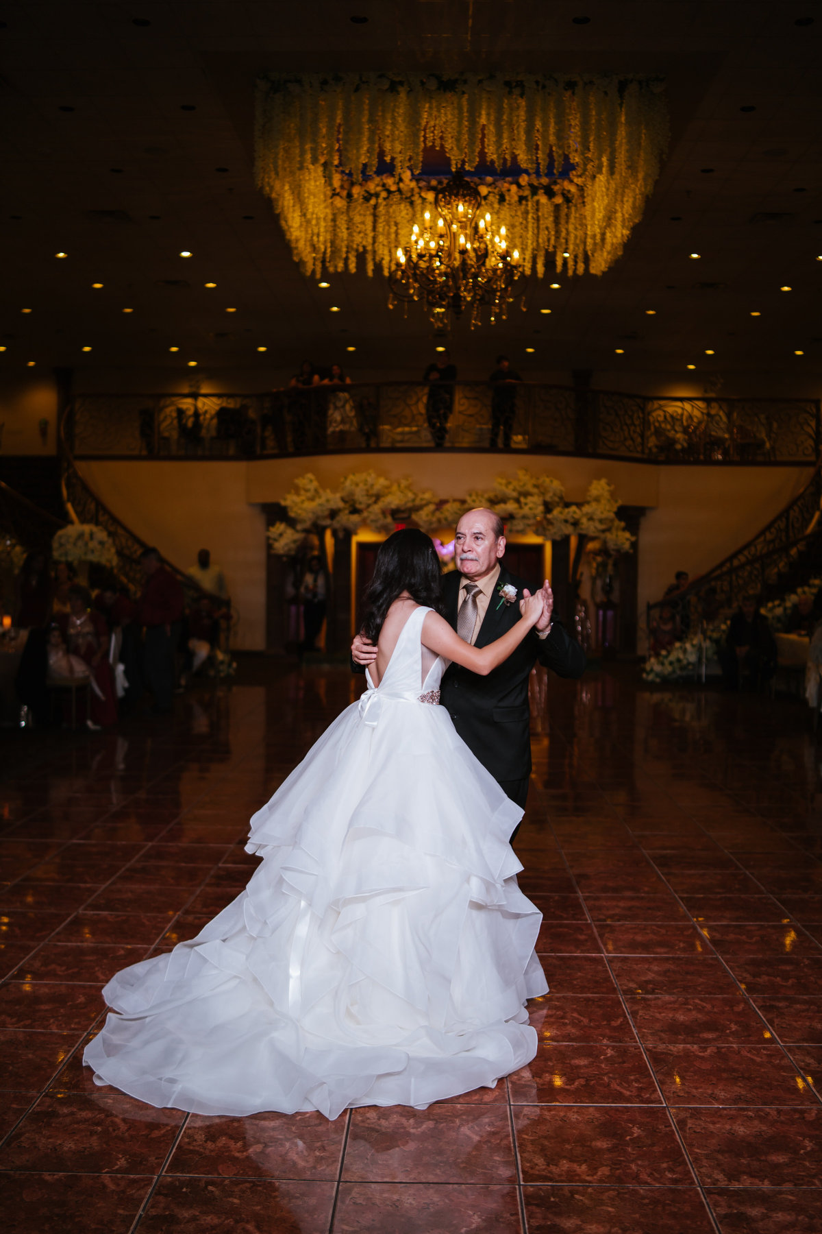 father dances with daughter during wedding reception at The Emporium by Yarlen venue in San Antonio