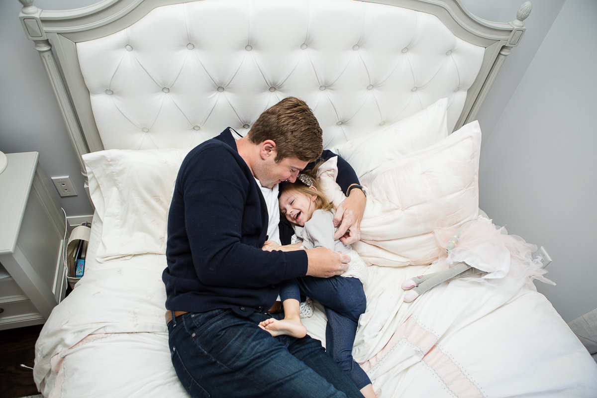 dad tickling daughter in her bed  {Etobicoke Lifestyle Photographer}
