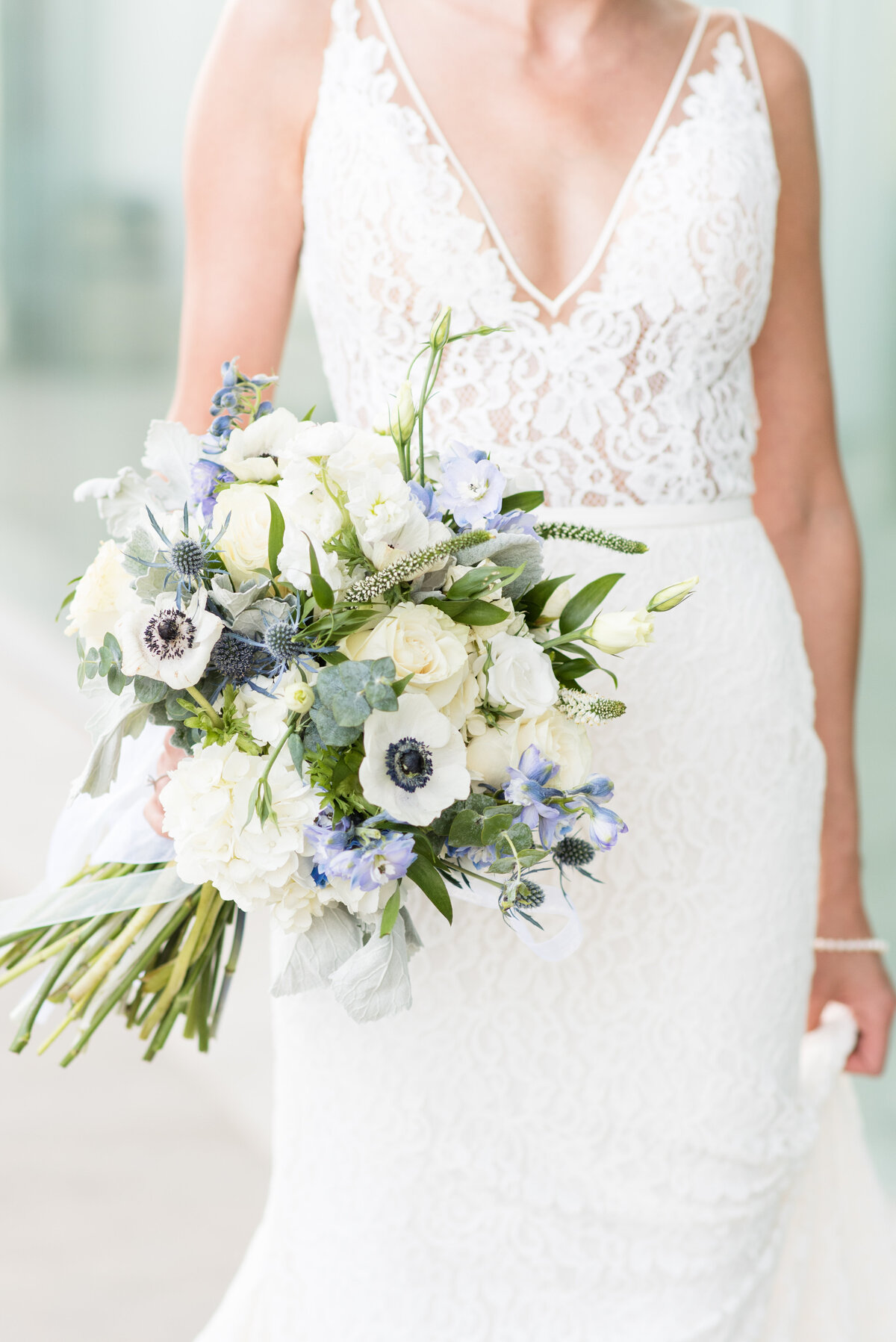 A beautiful blue and white bouquet by Velvet Rope Floral in Thunder Bay