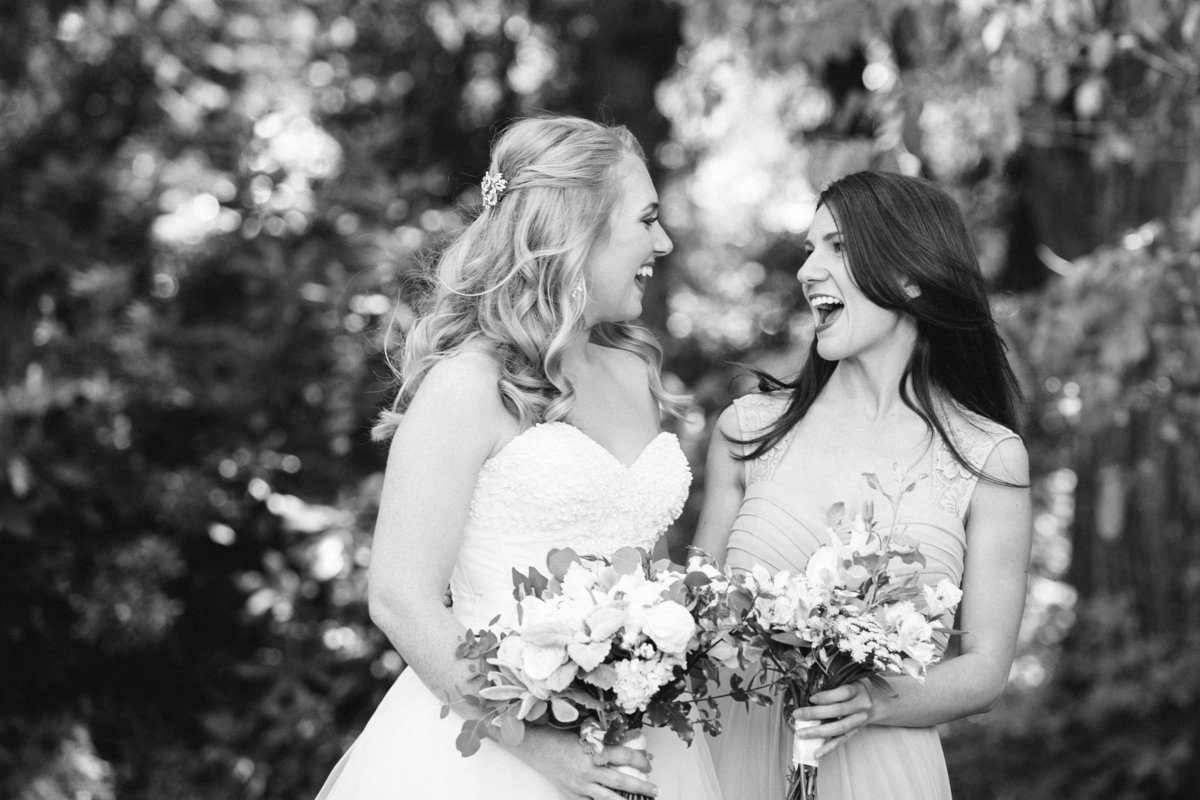 black and white photo of bride with bridesmaid