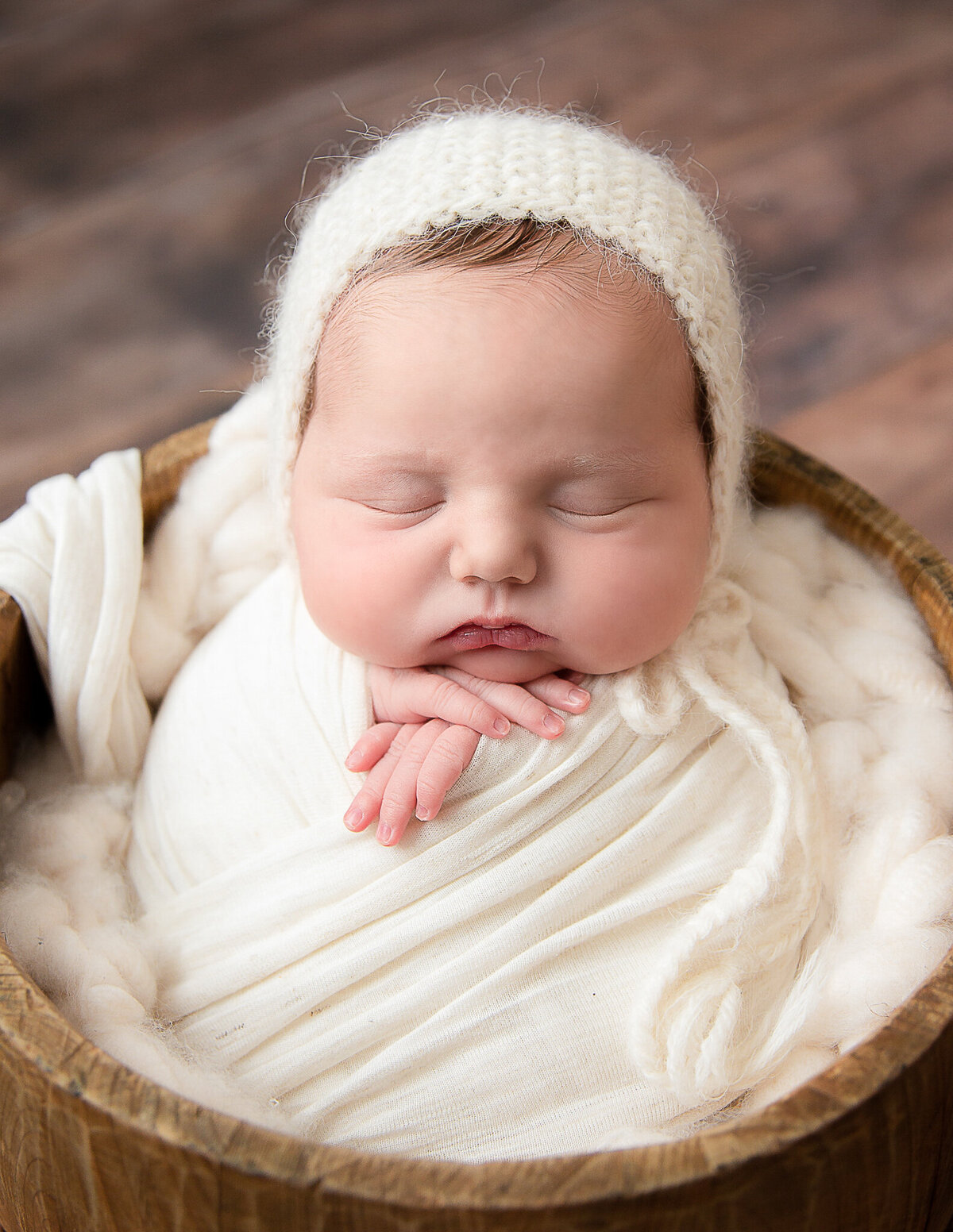 Posed newborn girl at our Rochester, Ny studio.