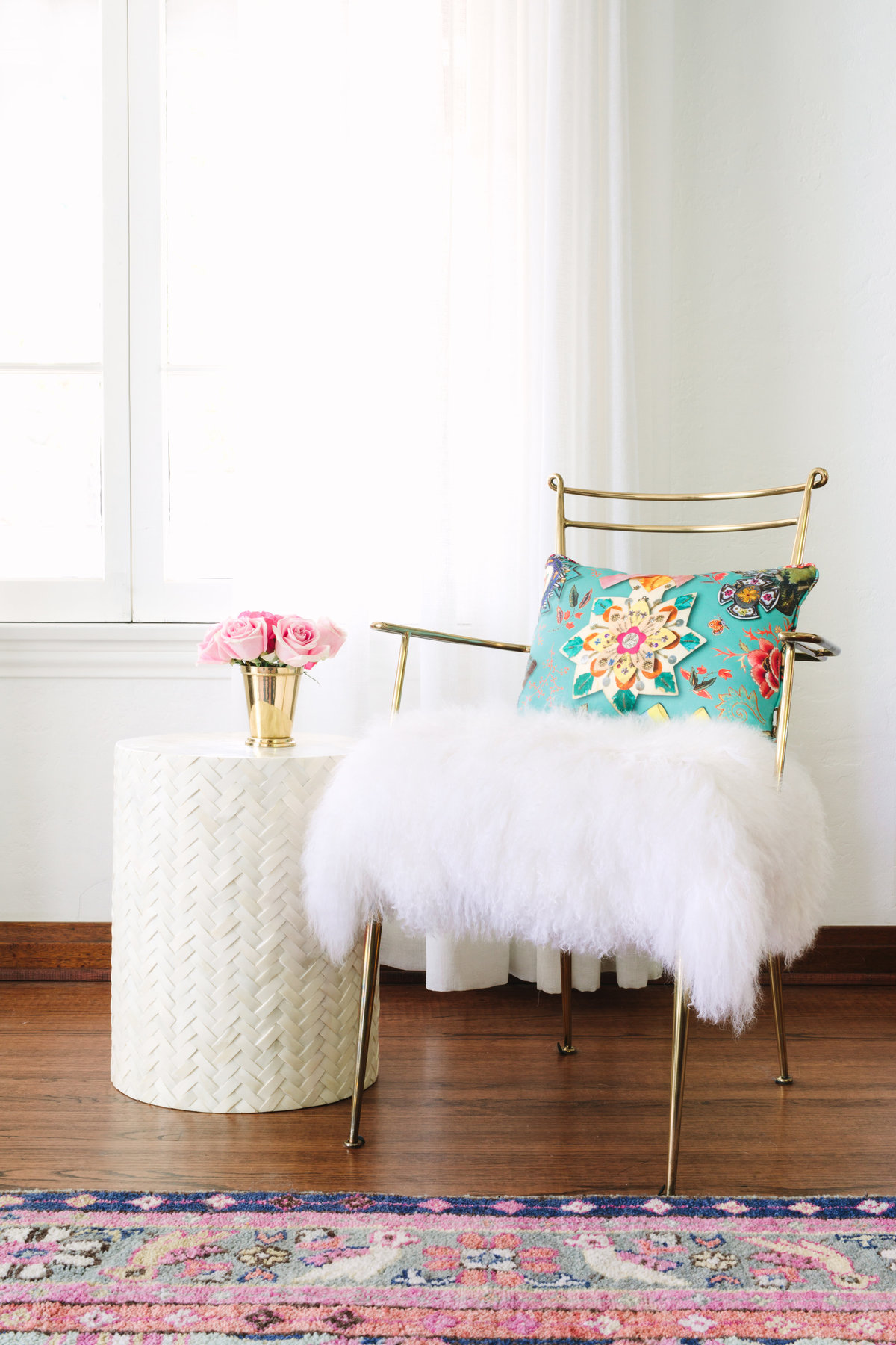 Gold chair with Mongolian lamb fluffy seat, bone inlay side table, and Caitlin Wilson Kismet rug