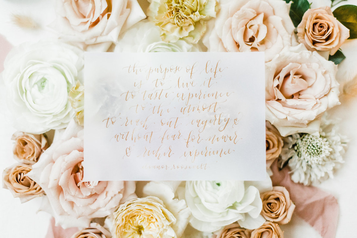 calligraphy quote on flowers