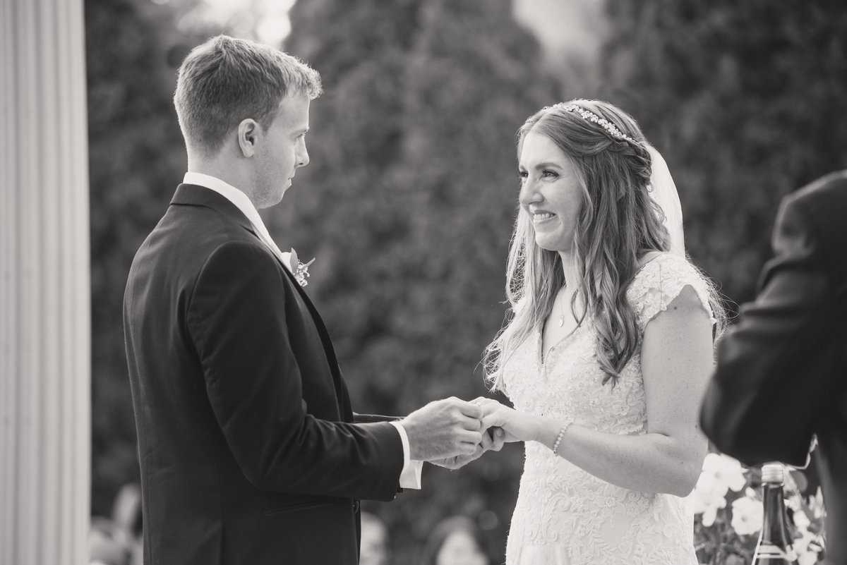 black and white wedding photo of bride and groom during ceremony at Willow Creek Golf and Country Club