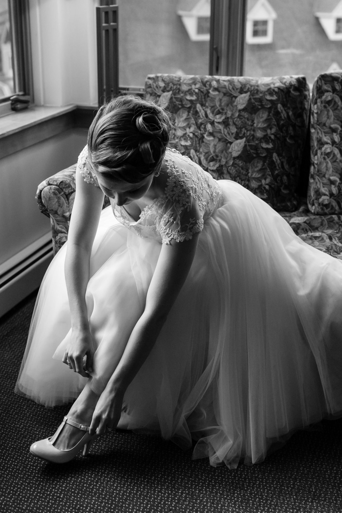 The bride gets her shoes ready before her elopement at Loon Mountain Resort in NH