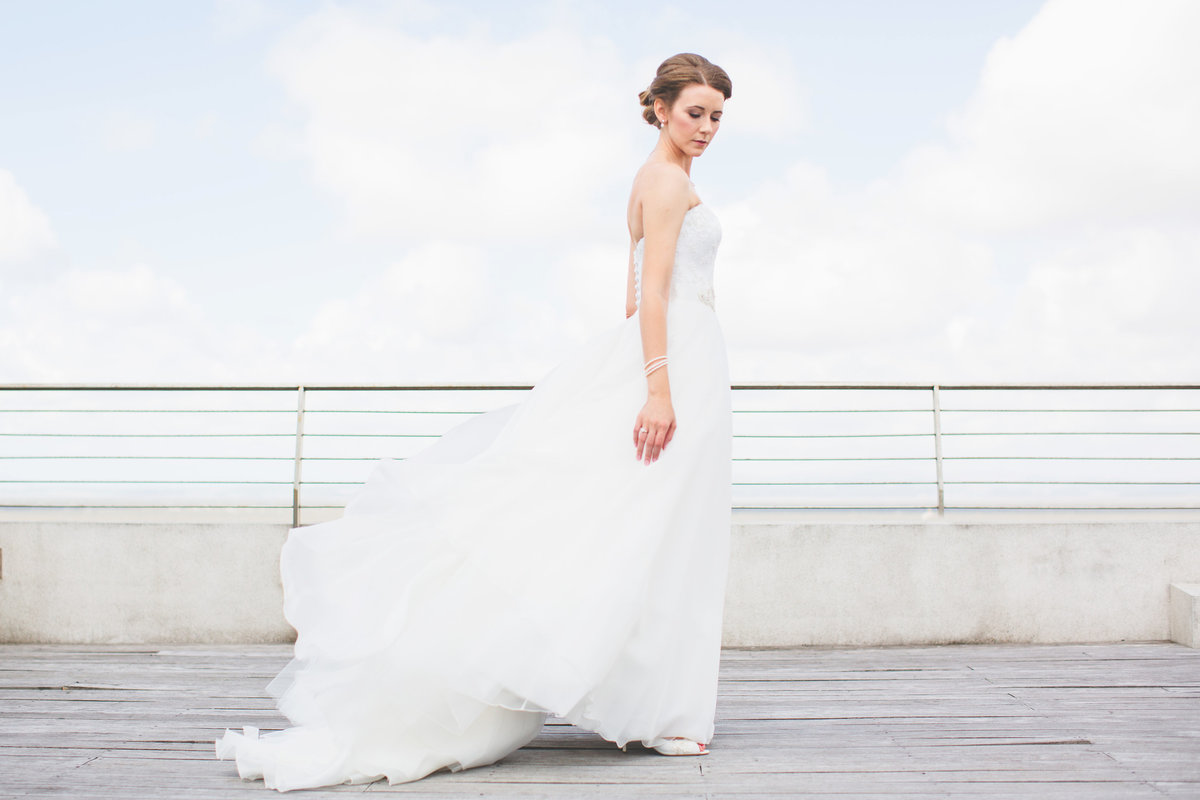 fashion style wedding portrait of a bride at the beach