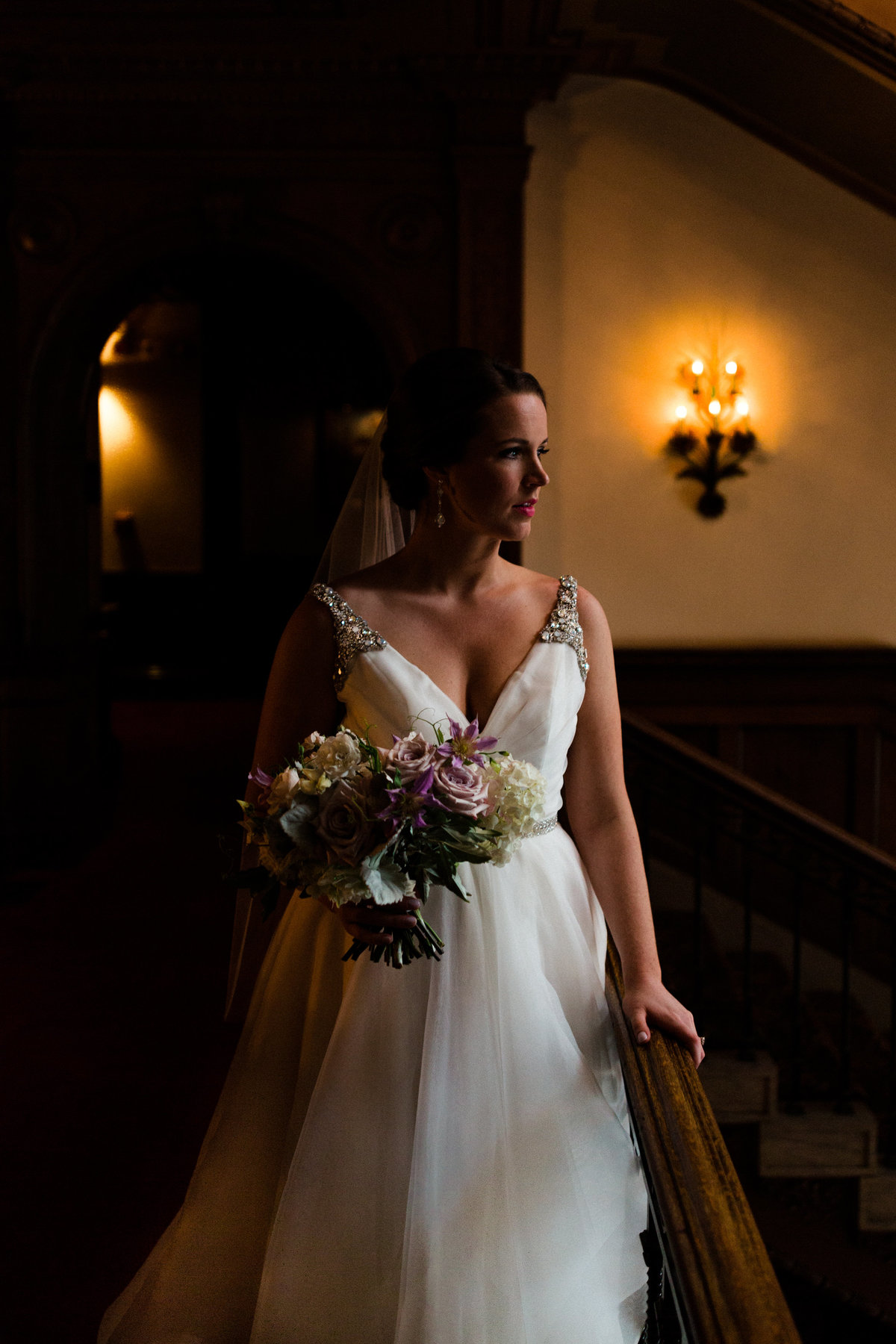 A dramatic portrait of a bride in her Miss Hayley Paige wedding gown from the Gown shop