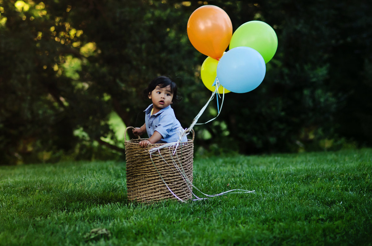 One year old birthday session with colorful balloons taken at Glenview Mansion in Rockville by Sarah Alice Photography