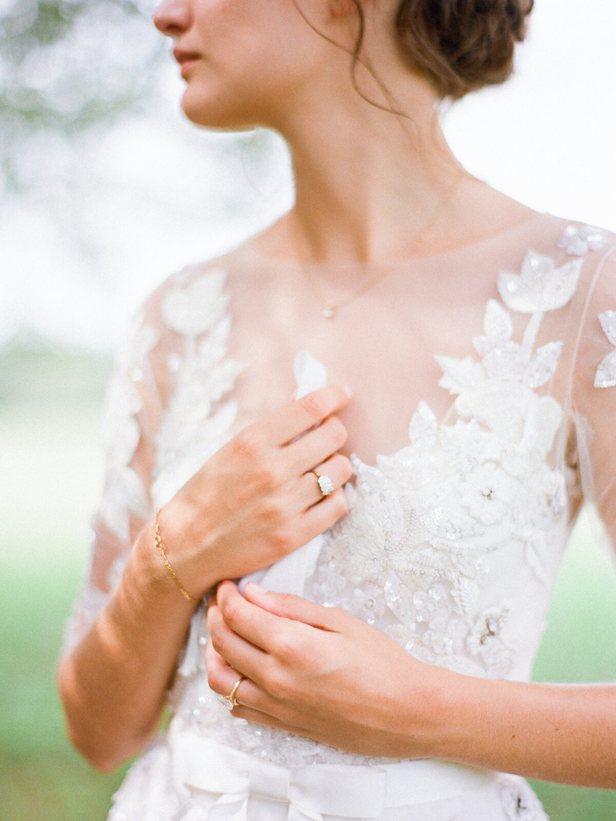 Close up of a bride's wedding dress bodice on her wedding day