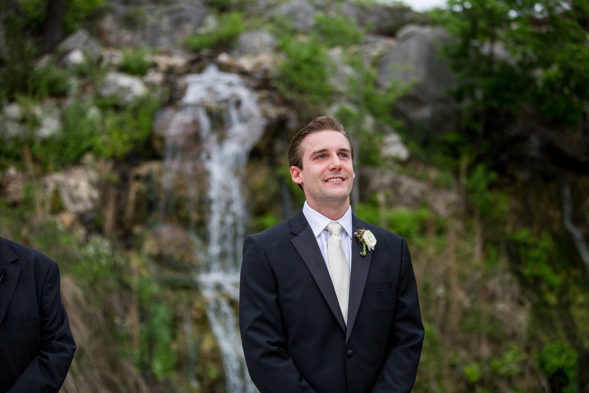 grooms reaction during first look as bride walks down aisle at Remi's Ridge at Hidden Falls  wedding venue
