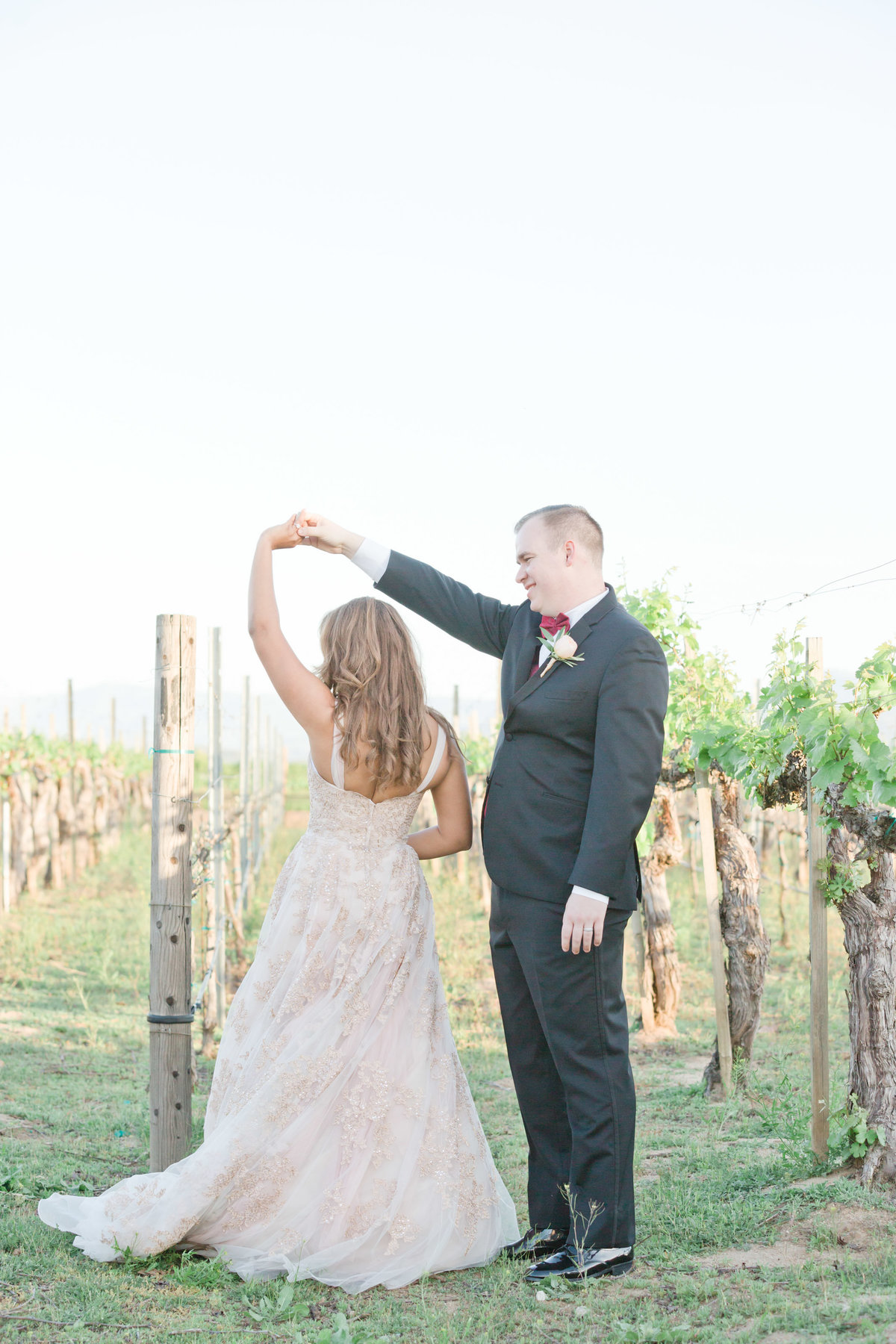 bride and groom dancing in the vineyard in temecula