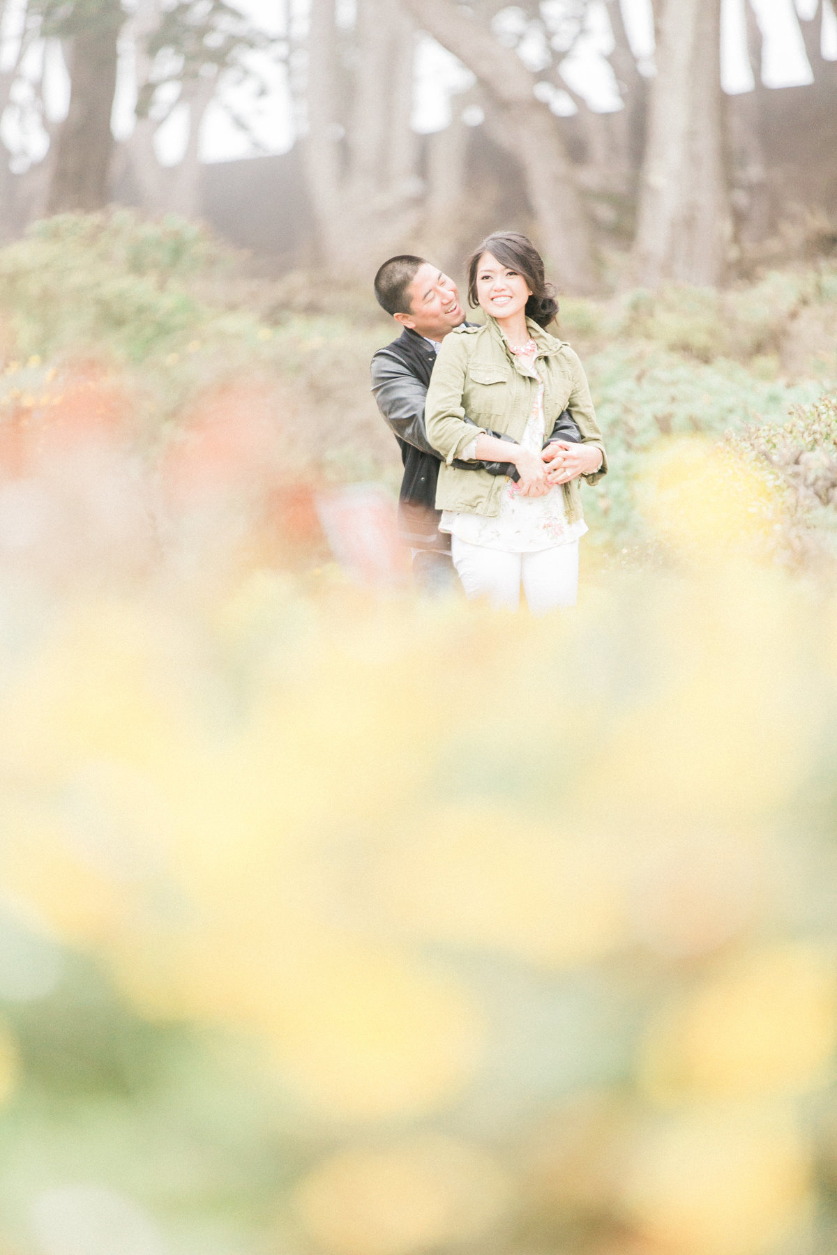 026_SFLandsEndTrail-yellowflowers-engagementsession
