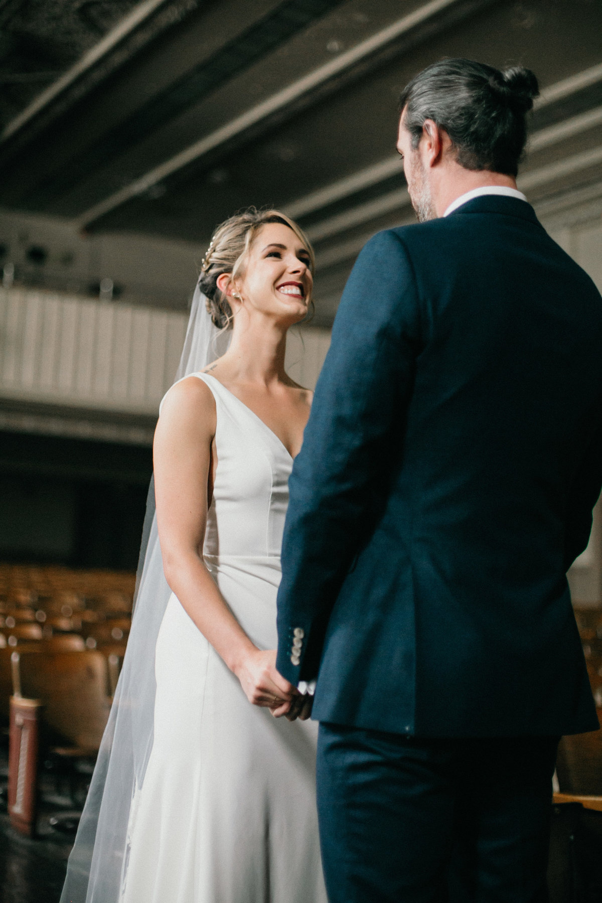 Bride and groom photographed together in this unique and  industrial Philadelphia wedding venue.