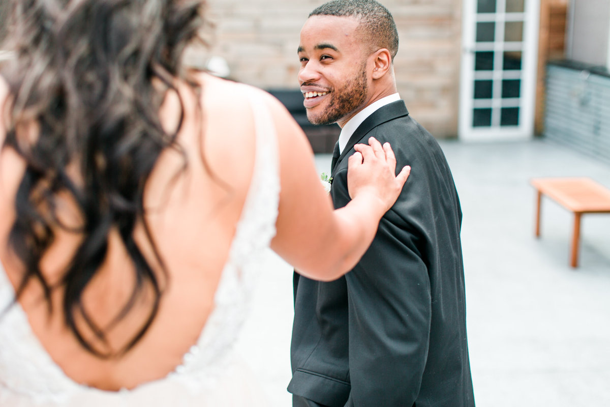 groom-first-look-reaction-seattle-wa-wedding-rooftop-tia-larue-photography