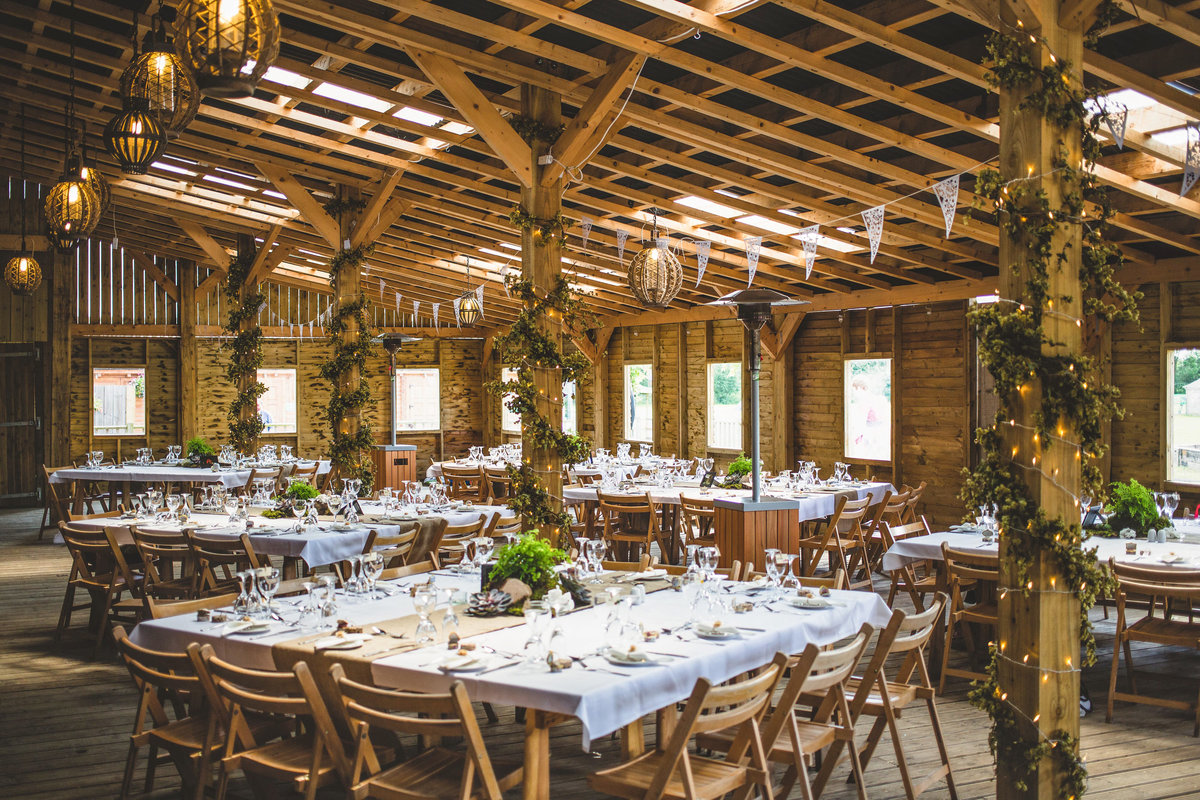 a wedding barn dressed for the weddign reception